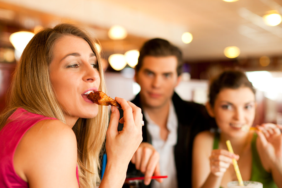 bigstock-Friends-in-Restaurant-eating-f-10164950