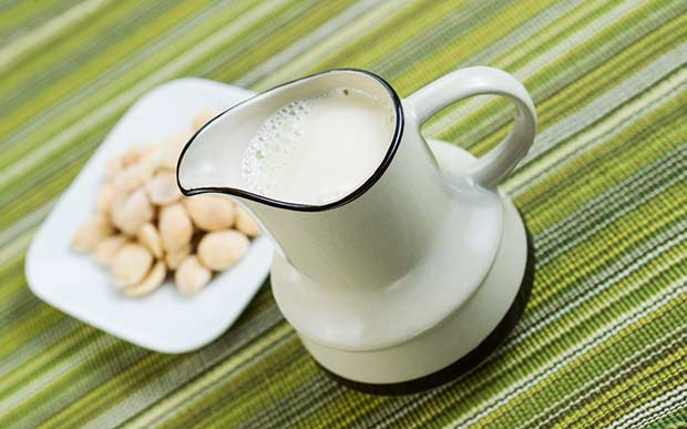 bigstock-Almond-Milk-In-Pourer-With-Alm-52364242