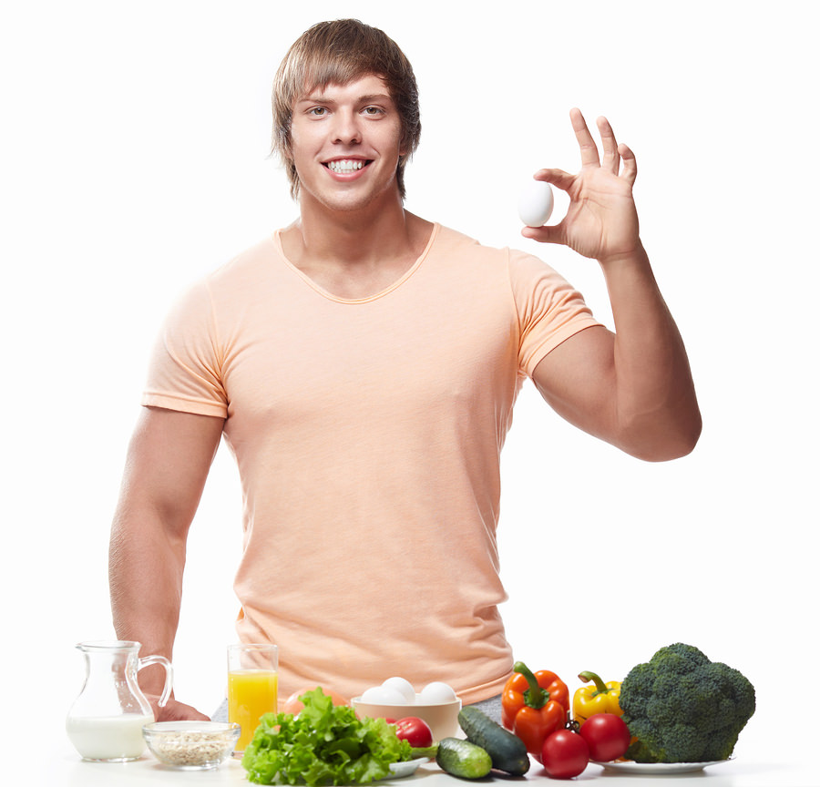 bigstock-Athletic-man-holding-chicken-e-47647705