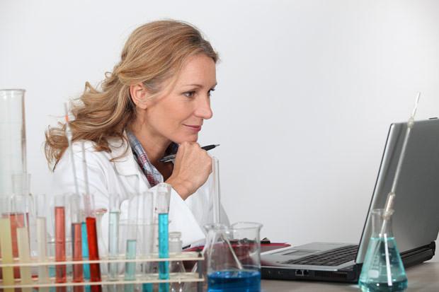 bigstock-Blond-researcher-in-lab-using--22173002