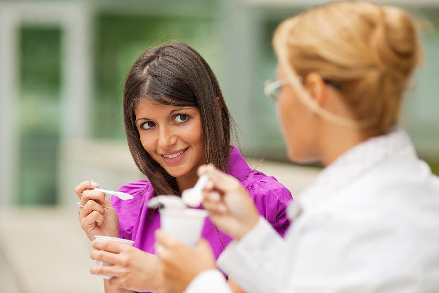 bigstock-Businesswomen-Eating-Yogurt-5302853
