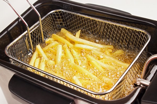 bigstock-Cooking-french-fries-48727343
