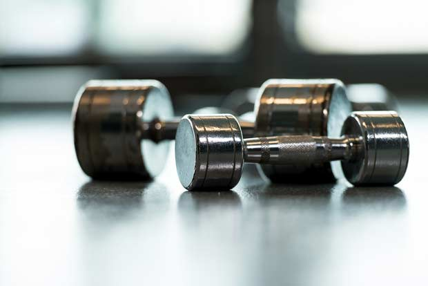 bigstock-Dumbbells-On-Floor-49016288