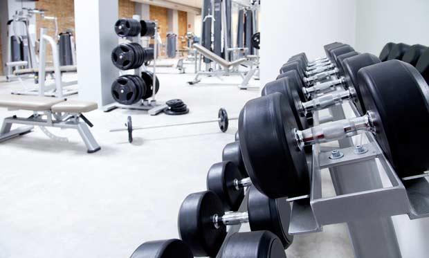 bigstock-Fitness-club-weight-training-e-29109284