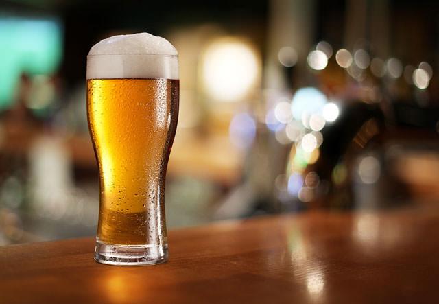 bigstock-Glass-of-light-beer-on-a-dark--39730978