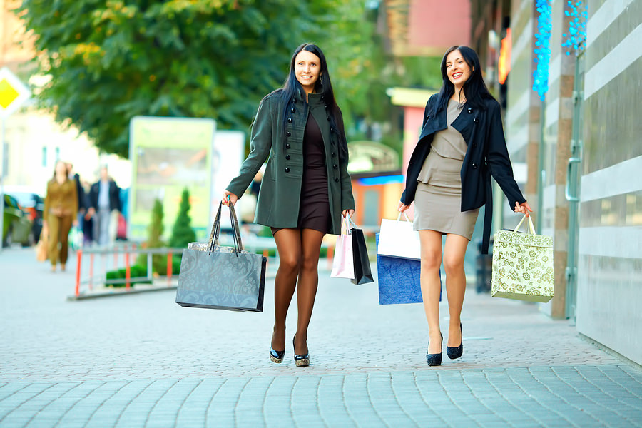 bigstock-Happy-Women-Walking-The-City-S-44481757