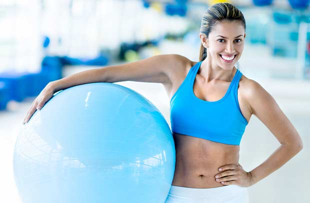 bigstock-Happy-woman-at-the-gym-holding-47205949