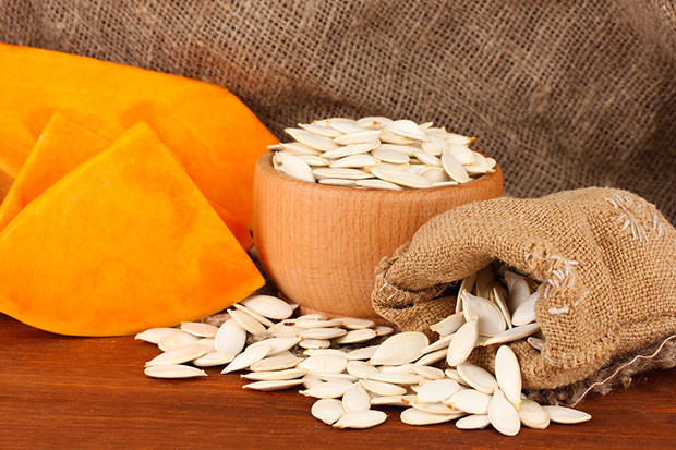 bigstock-Pumpkin-seeds-in-sack-on-wood-41365330