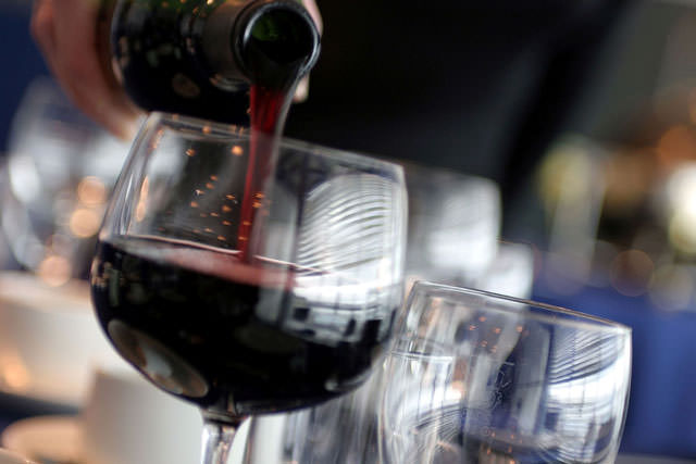 bigstock-Red-Wine-Poured-38890