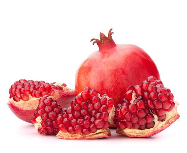 bigstock-Ripe-pomegranate-fruit-isolate-38718574