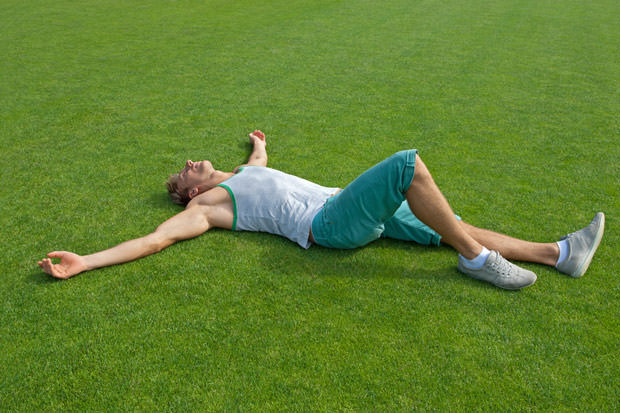 bigstock-Sporty-Guy-Relaxing-On-Green-T-36762511