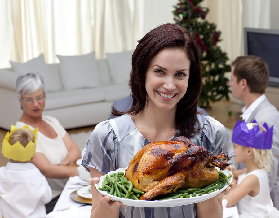 bigstock-Woman-Showing-Christmas-Turkey-6205071
