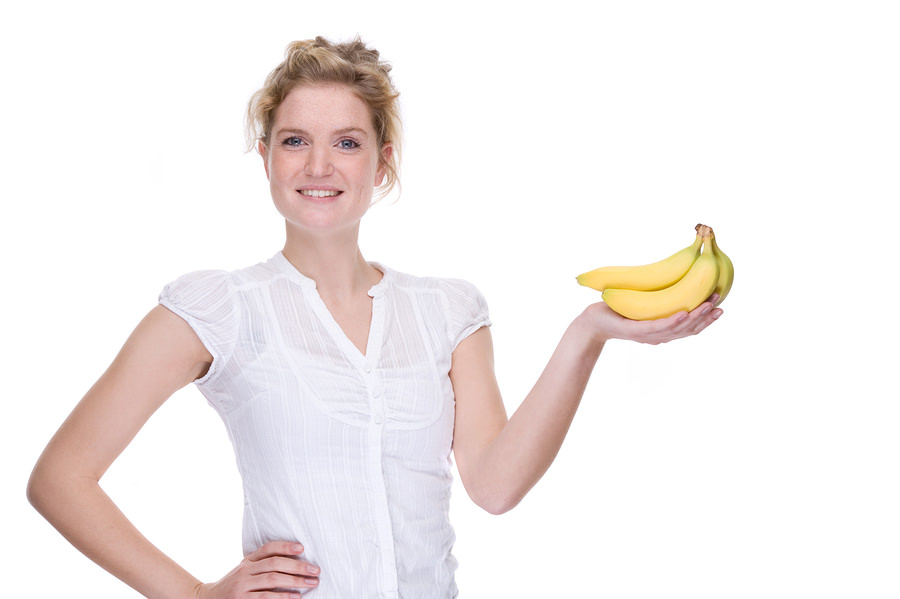 bigstock-Woman-With-Bananas-4235524