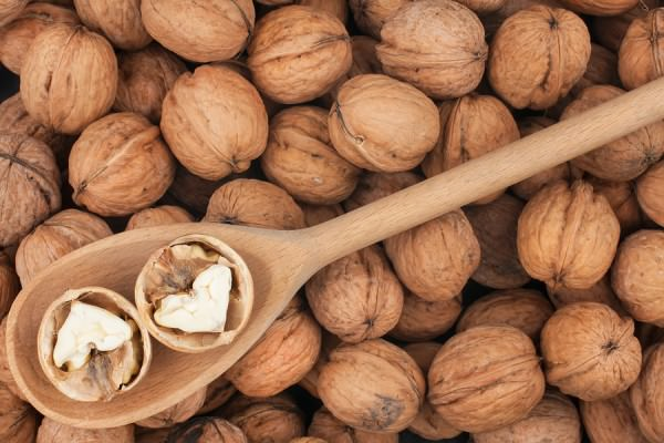 bigstock-Wooden-Spoon-With-Walnuts-47159005