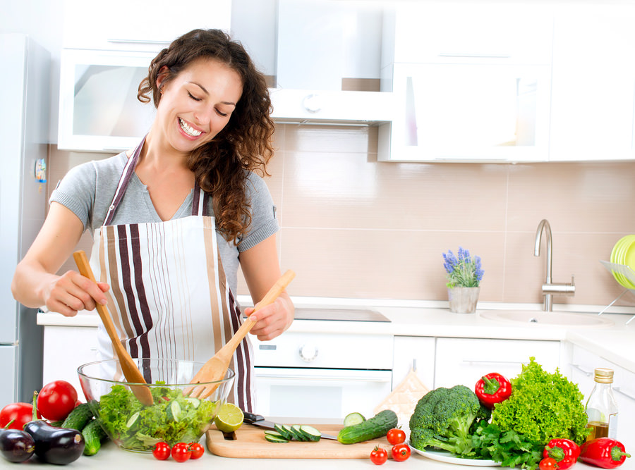 bigstock-Young-Woman-Cooking-Healthy-F-39028750