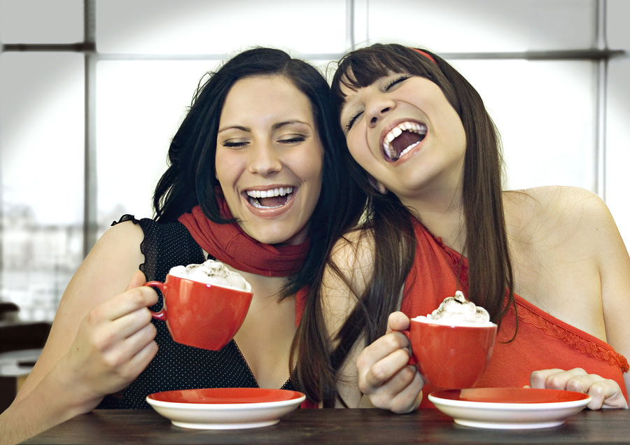 bigstock-two-girls-drinking-coffee-in-a-22222427