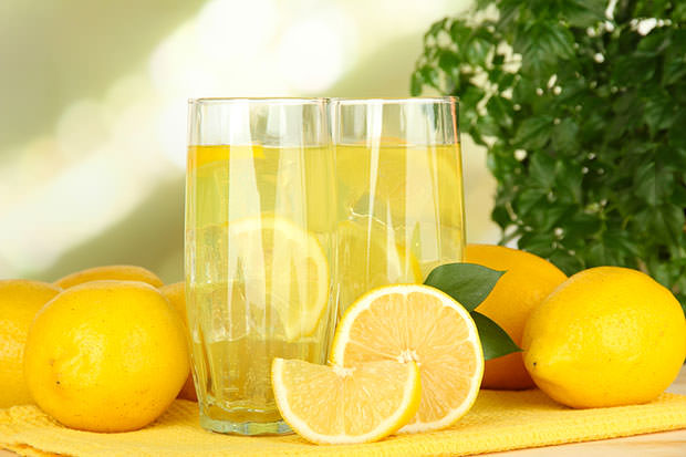 bigstock-Delicious-lemonade-on-table-on-48885410