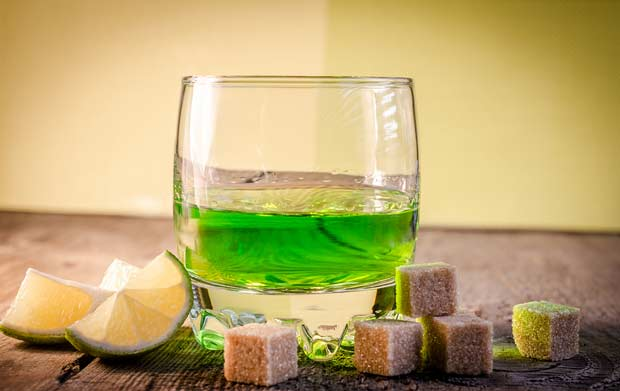bigstock-Glass-Of-Absinthe-With-Lime-An-58199072