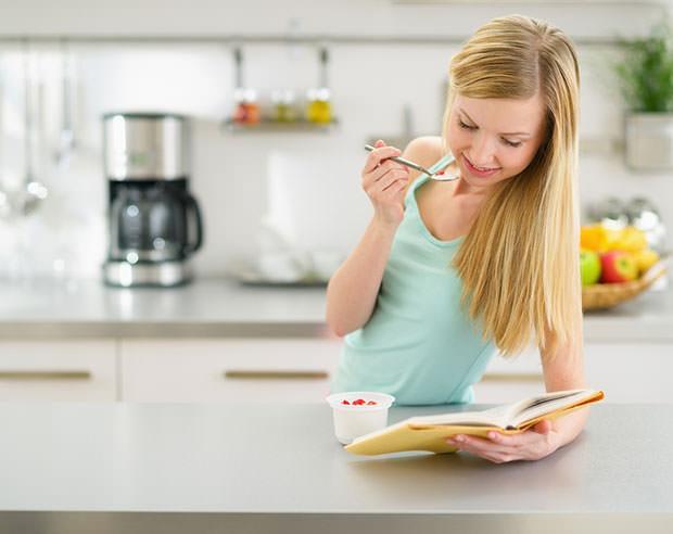 bigstock-Happy-Teenager-Girl-Reading-Bo-45648277