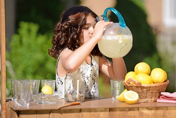 bigstock-little-girl-drinking-from-lemo-46954579