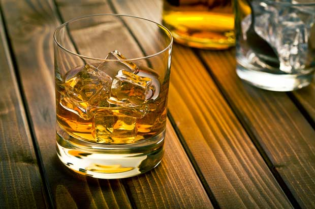 bigstock-whiskey-in-glass-with-ice-on-w-59111945