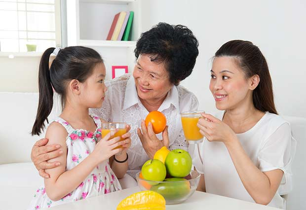 bigstock-Asian-family-drinking-orange-j-46656235