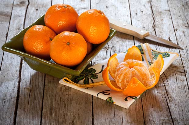 bigstock-Bowl-With-Honey-Tangerines-51924016