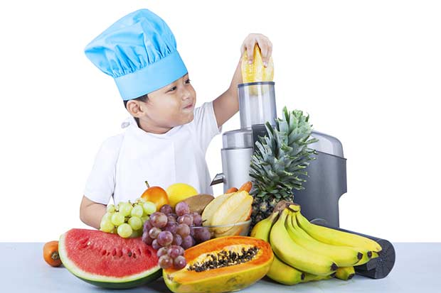 bigstock-Cute-Boy-Is-Making-Fruit-Juice-49690457
