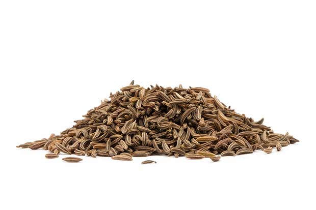 bigstock-Pile-of-cumin-seeds-isolated-o-53002282