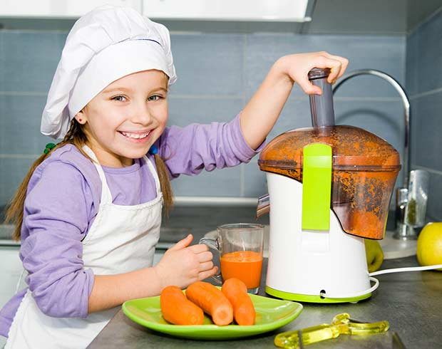bigstock-little-girl-making-carrot-juic-41734093