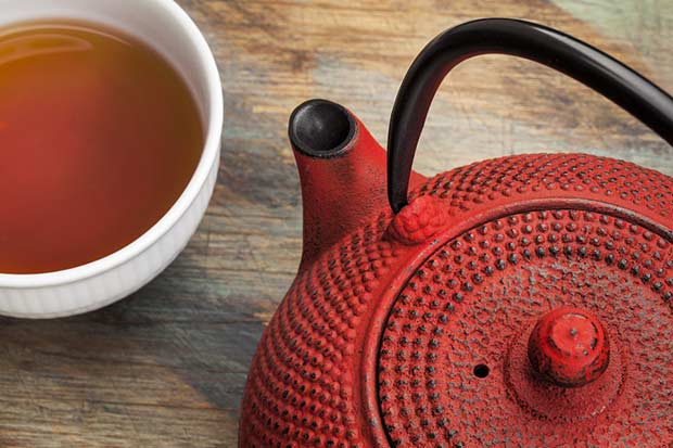 bigstock-red-tetsubin-with-a-cup-of-tea-48998345
