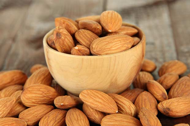 bigstock-Almond-in-wooden-bowl-on-wood-48279077