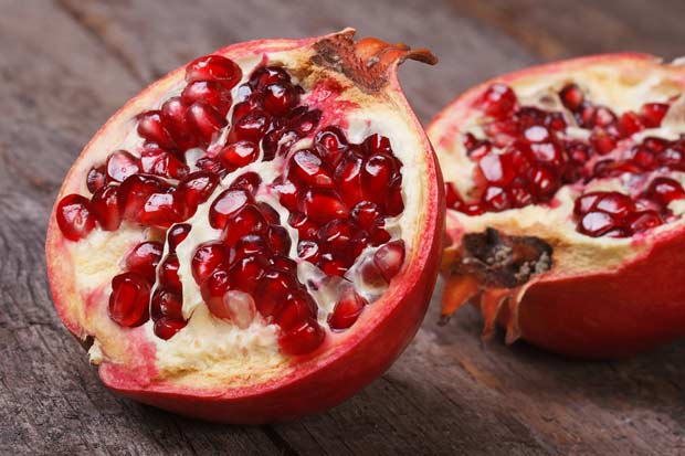 bigstock-Cut-Ripe-Pomegranate-On-An-Old-57706613