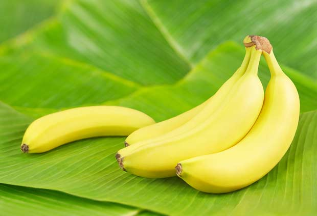 bigstock-Fresh-bananas-on-banana-leaves-46823329