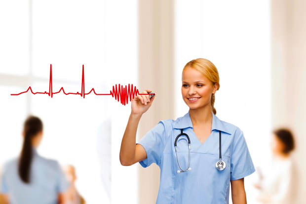 smiling doctor or nurse drawing electrocardiogram