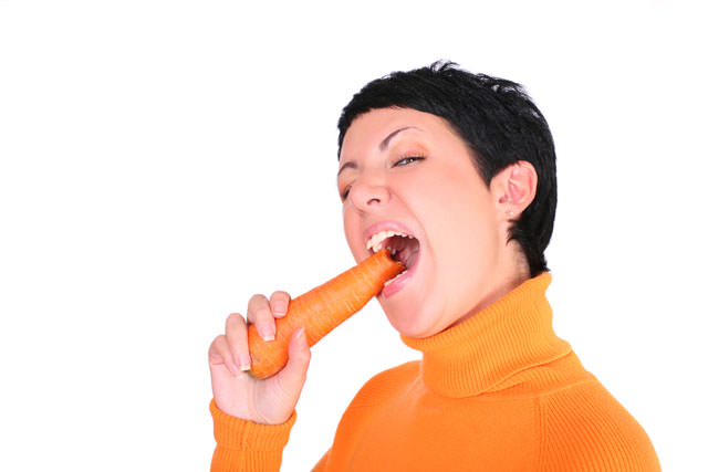 Funny woman with a carrot