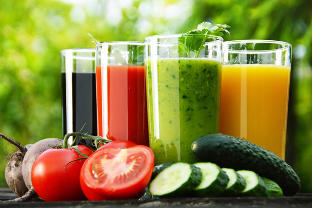 Glasses with fresh vegetable juices in the garden. Detox diet