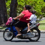 Mother and Daughter Riding Motor Bike